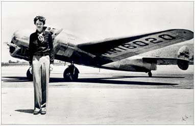 Amelia Earhart posing in front of her Lockheed Electra plane