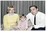 Collette  MacDonald with husband and daughter