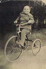 E. L. Doctorow riding a bike as a child