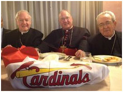 Cardinals Egan, Dolan and Justin Rigali with a Cardinals Baseball uniform