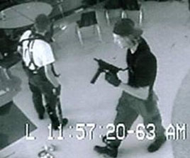 video surveilance of Eric Harris and Dylan Klebold holding guns