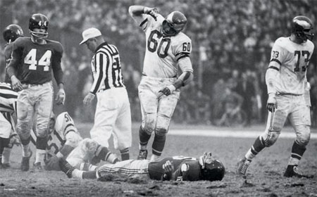 Frank Gifford hurt on the field