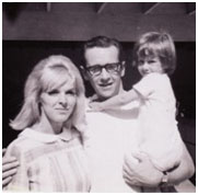 George Carlin with his wife and child
