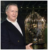 George Steinbrenner holding the world series trophy