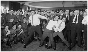 Henry Houdini getting punched by Jack Dempsey
