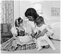 Jacqueline Kennedy Onassis with her children, Caroline and John
