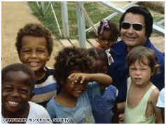 Jim Jones with his adopted children
