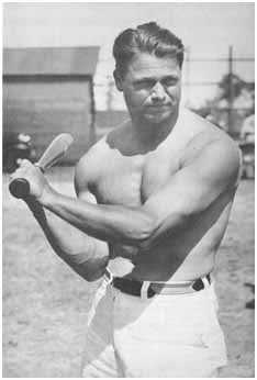 Jimmy Foxx swinging a bat with no shirt on