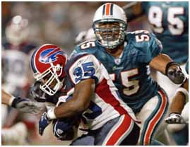 Junior Seau playing for the dolphins