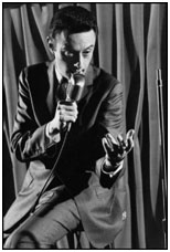 Lenny Bruce performing on stage