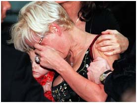 Michael Hutchence family crying at a memorial service