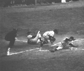 Monte Irvin stealing home