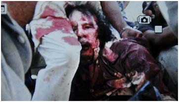 Muammar Gaddafi dragged through the streets