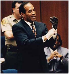 O.J. Simpson Trying on Glove