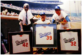 jackie Robinson, Roy Campanella lighting, and Sandy Koufax retired numbers