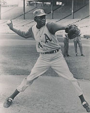 Satchel Paige pitching at age 59