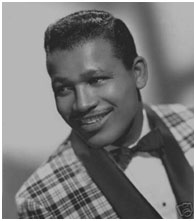 Sugar Ray Robinson wearing a colorful tuxedo