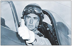 Ted Williams sitting in the cockpit of a military plane