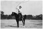 Will Rogers on a horse with a lariat